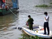 Tin tức trong ngày - Thi thể người phụ nữ mắc cành tre nổi trên sông Hồng