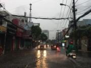 Tin tức trong ngày - Trời Sài Gòn bất ngờ đổ mưa như trút nước vào giờ tan tầm