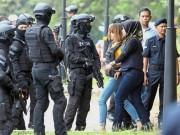 Thế giới - Vì sao Đoàn Thị Hương phải mặc áo chống đạn khi rời tòa?