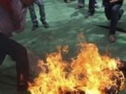 Vợ nghi tưới xăng đốt chồng rồi nhảy sông tự tử