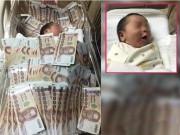 Bạn trẻ - Cuộc sống - Sốc với cậu bé Thái Lan vừa ra đời đã được đắp tiền khắp người