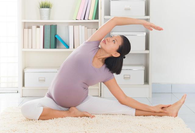 Bí quyết chặn đứng cơn đau lưng ê ẩm khi mang thai - 1