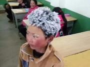 Thế giới - Cậu bé TQ bị đóng băng toàn bộ tóc vì trời giá rét
