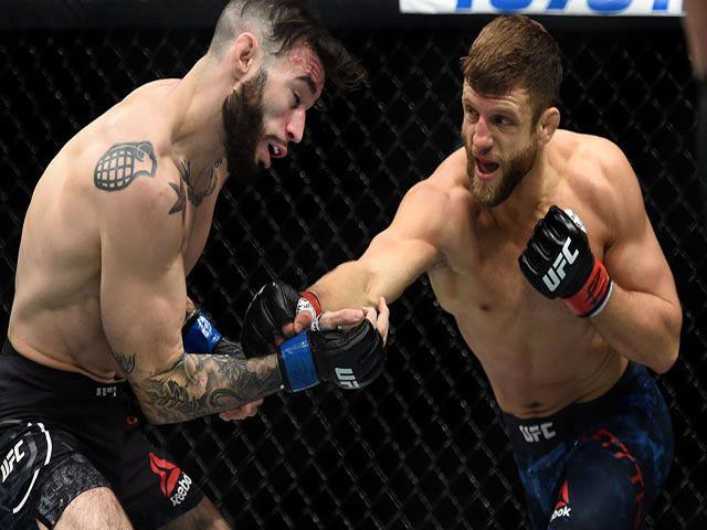 UFC, choảng nhau như bụi đời: Đè vật đối thủ, đấm không nương tay 1
