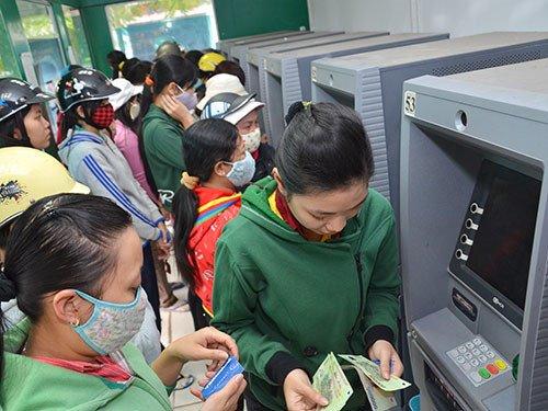 Những lưu ý sử dụng thẻ ATM an toàn trong dịp Tết - 1