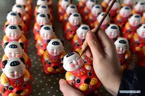 Rực rỡ sắc đỏ Tết Nguyên đán tại làng nghề Trung Quốc - 4