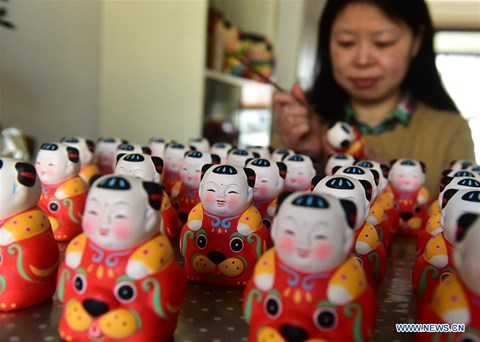 Rực rỡ sắc đỏ Tết Nguyên đán tại làng nghề Trung Quốc - 6