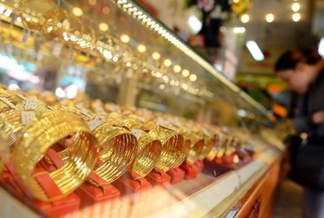 Giá vàng đột ngột giảm mạnh, tỷ giá đi ngang