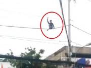 Hoảng hồn thanh niên nhảy múa trên dây điện giữa SG