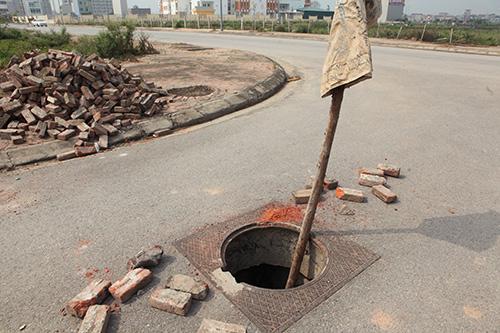 Hàng trăm nắp hố ga tại Hà Nội không cánh mà bay - ảnh 4