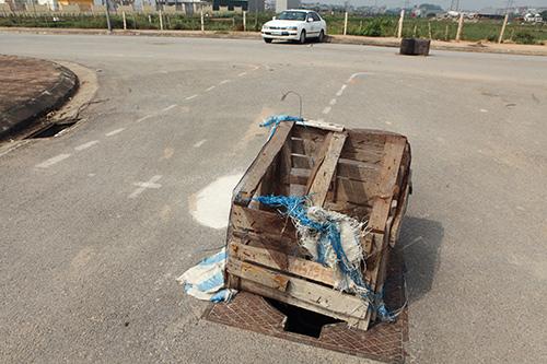 Hàng trăm nắp hố ga tại Hà Nội không cánh mà bay - ảnh 11