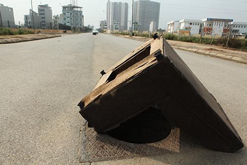 Hàng trăm nắp hố ga tại Hà Nội không cánh mà bay - ảnh 10