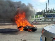 Bốc cháy cả người, thanh niên đi mô tô phi xuống cầu Bến Lức