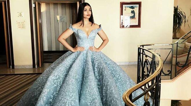 Hoa hậu đẹp nhất thế giới diện váy xẻ sâu hun hút ở Cannes - 6