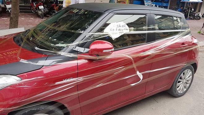 """Tin mới vụ ô tô bị dán dòng chữ """"Lần sau đỗ xe ở đây đừng trách tao"""" - 1"""