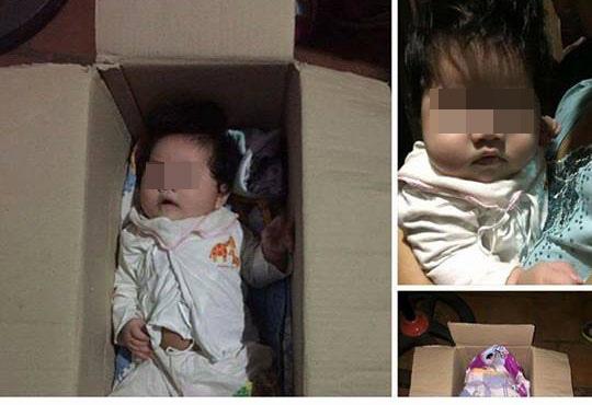 HN: Bé gái kháu khỉnh bị bỏ rơi trong thùng giấy trước cửa nhà dân - 1