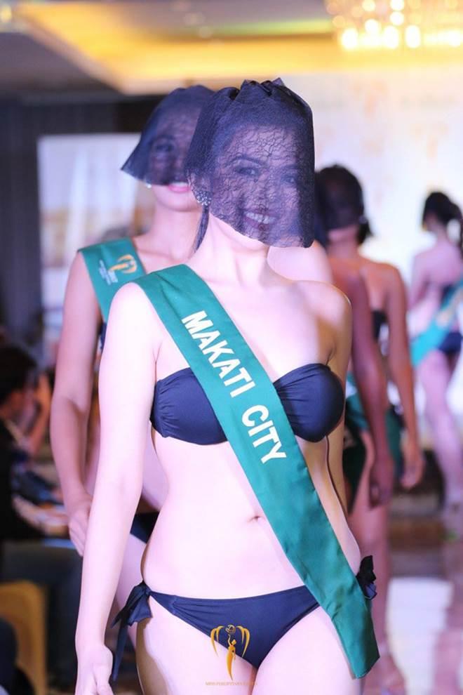 Người đẹp HH Trái đất mặc bikini, che mặt kín mít kỳ quặc