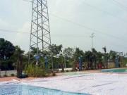 Tin tức trong ngày - Giật mình bể bơi xây dưới chân cột điện cao thế 110KV