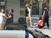 Bạn trẻ - Cuộc sống - Cô gái bị xé quần áo, cắt tóc trên phố vì nghi ngoại tình