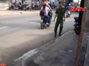 Video An ninh - Hai thanh niên bị giang hồ truy sát trong đêm