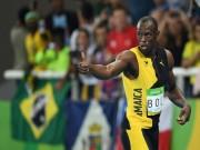 """Thể thao - Usain Bolt thần tốc giành """"hat-trick"""" HCV"""