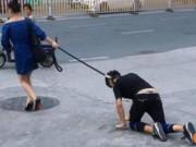 Phi thường - kỳ quặc - Người phụ nữ dắt người đi dạo trên phố như chó cưng
