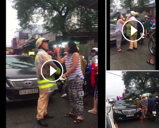 Nữ tài xế chửi bới, túm cổ áo CSGT vì bị nhắc nhở chạy sai làn - ảnh 1
