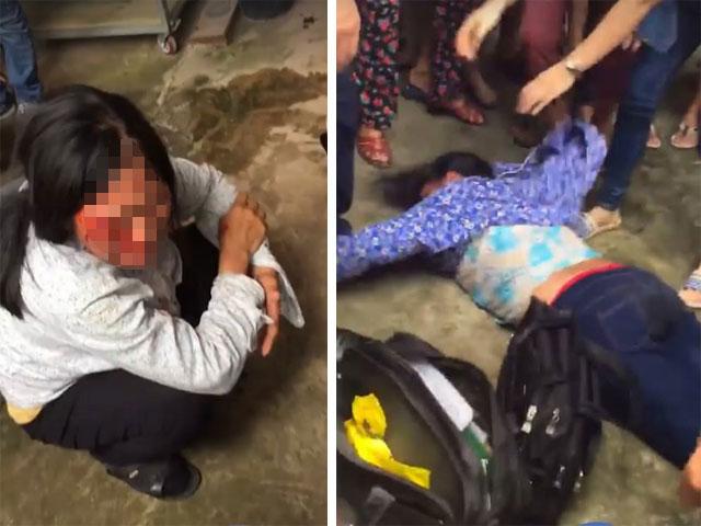 HN: Nghi bắt cóc trẻ con, 2 người phụ nữ bị dân vây đánh tả tơi - 1
