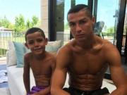 Ronaldo cắt tóc cho con, không màng tin đồn đẻ sinh đôi_