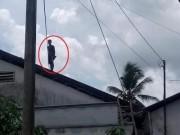 Thanh niên nghi ngáo đá, cố thủ 8 tiếng trên nóc nhà