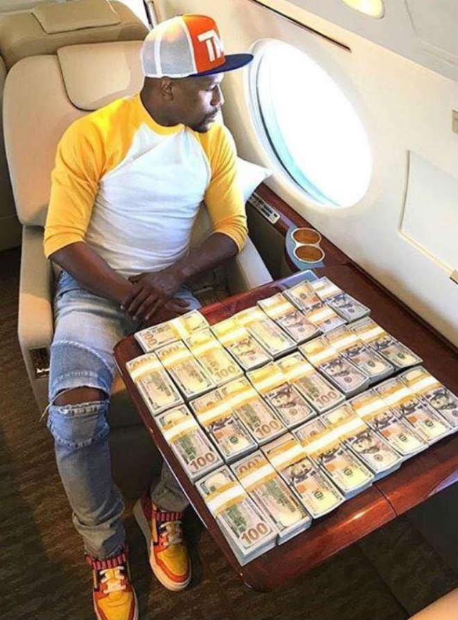 """Đấm gục McGregor, """"Độc cô cầu bại"""" Mayweather cán mốc 1 tỷ USD - 1"""