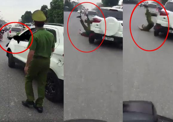 Thót tim xem clip ô tô đánh võng hất văng cảnh sát từ capô xuống đường - 1