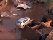 Thế giới - Ô tô mắc trên mái nhà sau lũ do vỡ đập ở Brazil