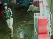 An ninh Xã hội - Clip: Tên cướp xông vào tiệm uốn tóc giật điện thoại
