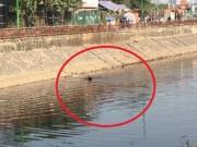 An ninh Xã hội - Hà Nội: Bị truy đuổi, cướp lao xuống sông thối