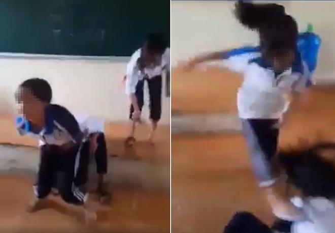 Nữ sinh cấp 2 bị bạn đánh dã man, xé áo hở cả nội y trên bục giảng - 1