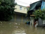 Mưa suốt đêm, thành phố Vinh chìm trong biển nước