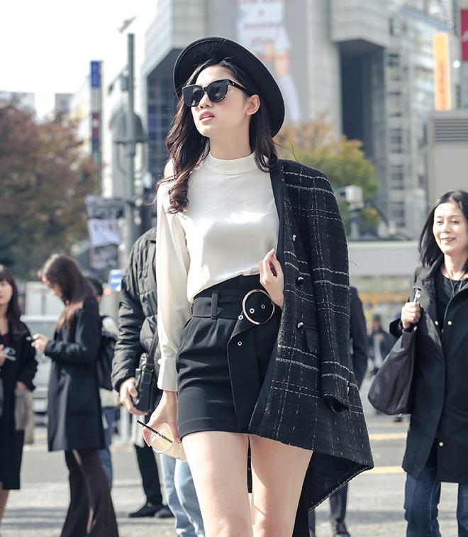 Á hậu Thanh Tú mặc mát mẻ giữa trời giá rét tại Nhật - 7