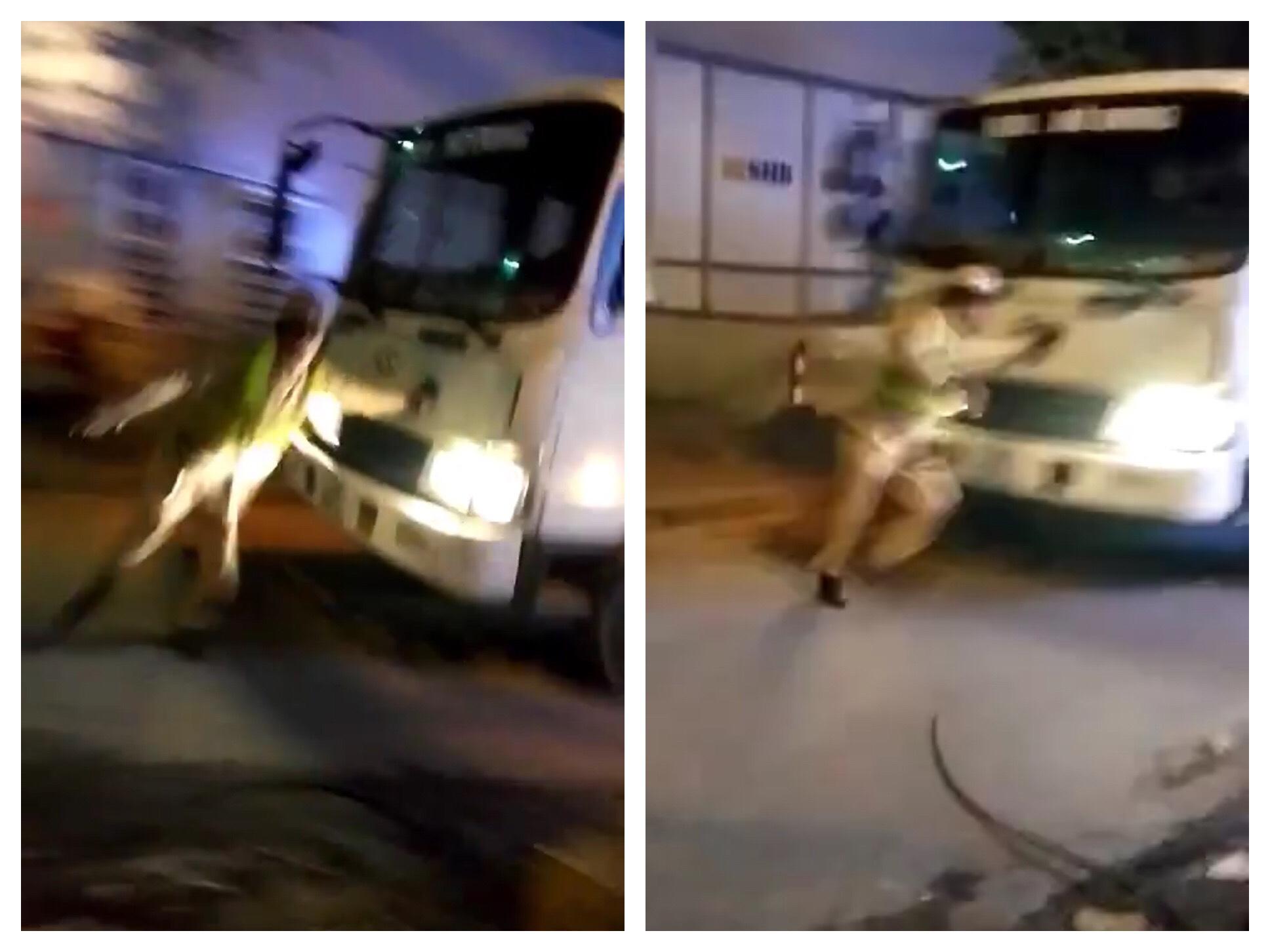 Thót tim xem clip CSGT bị xe tải đâm, phải nhảy khỏi đầu xe thoát thân - 1